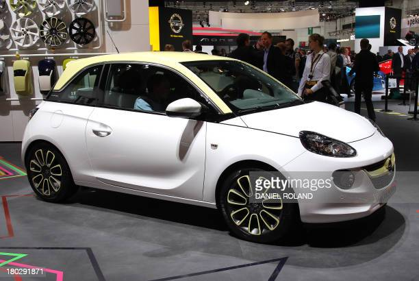An Opel Adam car is seen at the IAA international motor show in Frankfurt am Main Germany on September 11 2013 AFP PHOTO / DANIEL ROLAND