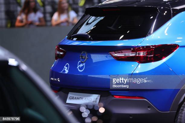 An Opel AG Grandland X automobile manufactured Adam Opel AG a unit of the PSA Group stands on display during the first media preview day of the IAA...