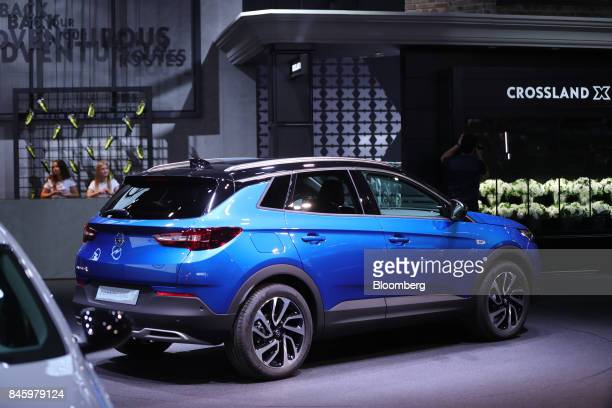 An Opel AG Grandland X sports utility vehicle manufactured Adam Opel AG a unit of the PSA Group stands on display during the first media preview day...