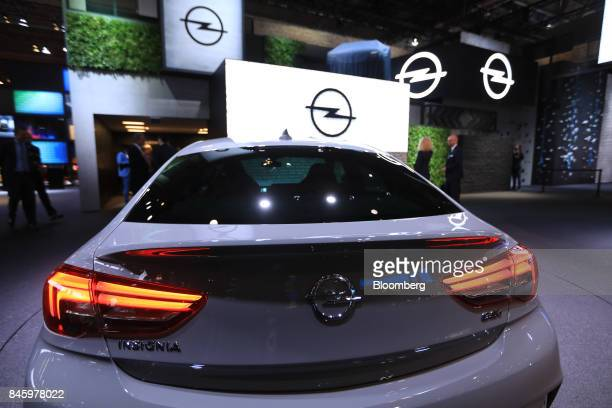 An Opel AG Insignia automobile manufactured Adam Opel AG a unit of the PSA Group stands on display during the first media preview day of the IAA...