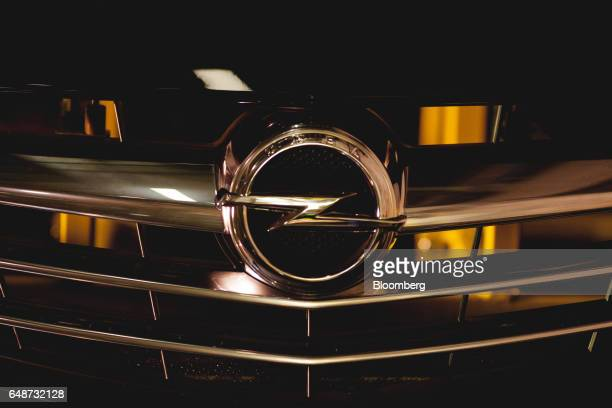 An Opel badge sits on the front grill of an Opel Astra vehicle at the Opel automobile plant in Gliwice Poland on Monday March 6 2017 The maker of...