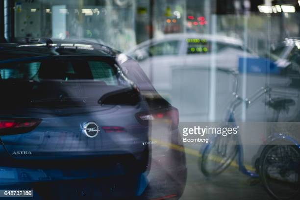 An Opel badge sits on the trunk of an Opel Astra vehicle at the Opel automobile plant in Gliwice Poland on Monday March 6 2017 The maker of Peugeot...
