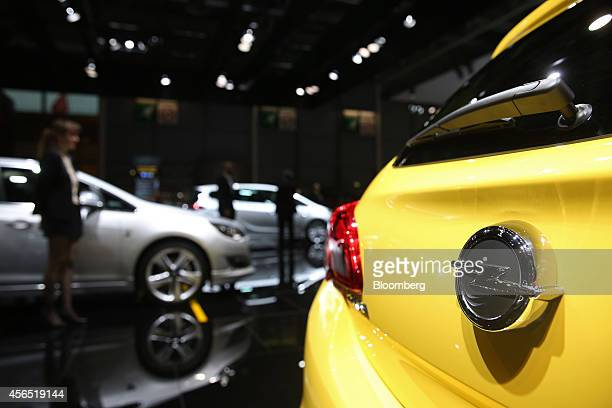 An Opel Corsa sits on display during its unveiling at the Adam Opel AG stand on the first preview day at the Paris Motor Show in Paris France on...