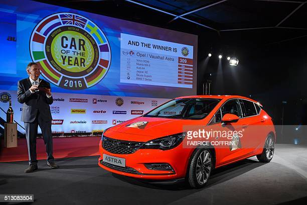 An Opel Vauxhall Astra model car is displayed after being awarded 'Car of the year 2016' on the eve of the press day of the Geneva Motor Show on...