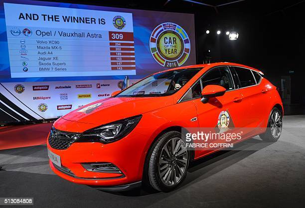 An OpelVauxhall Astra model car is displayed after being awarded 'Car of the year 2016' on the eve of the press day of the Geneva Motor Show on...
