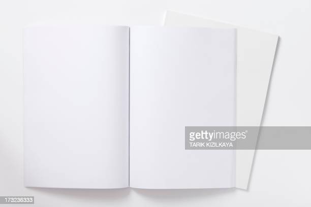 an open blank notebook ready to be filled - magazine page stock photos and pictures