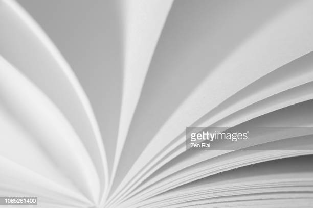an open book showing edges of the pages in black and white - category:pages stock pictures, royalty-free photos & images