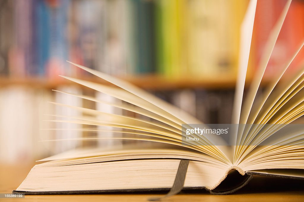 An open book with a leather bookmark : Stock Photo