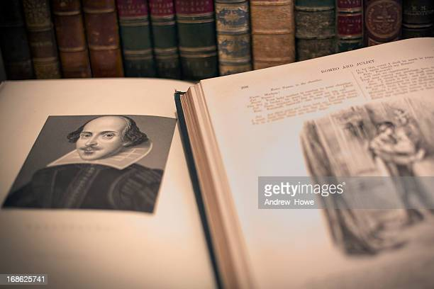 An open book with a William Shakespeare portrait