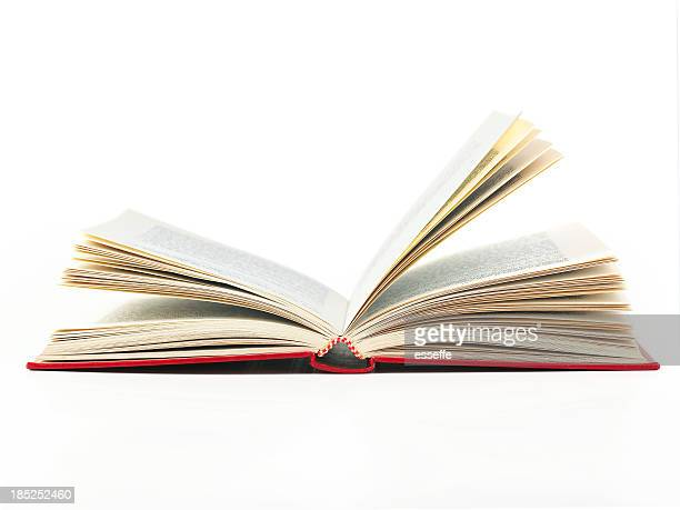 An open book with red cover on a white background