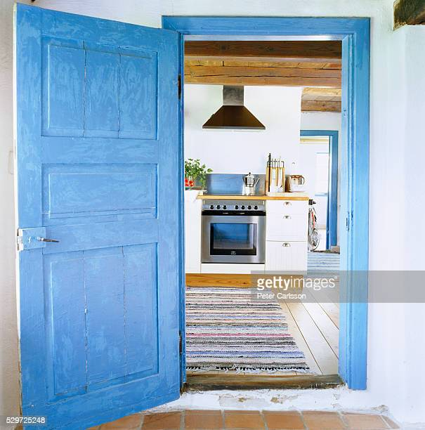 an open door into the kitchen sweden - doorway stock pictures, royalty-free photos & images