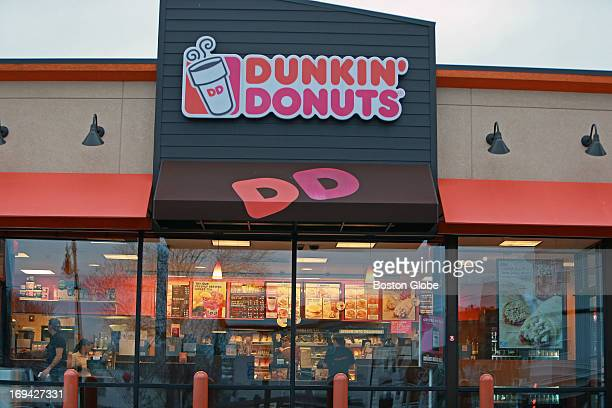 An open Dunkin' Donuts shop at the corner of Dorchester Avenue and Boston Street in Dorchester