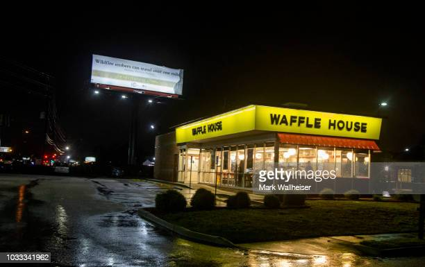An open Florence South Carolina Waffle House sits deserted as the center of Tropical Storm Florence blows through on September 14 2018 in Florence...