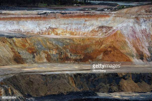 An open pit mine stands at a Talison Lithium Ltd site a joint venture between Tianqi Lithium Corp and Albemarle Corp in Greenbushes Australia on...