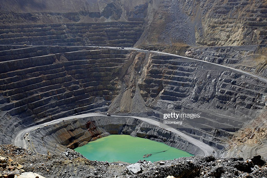 An open pit sits in the Batu Hijau copper and gold mine operated by PT Newmont Nusa Tenggara in Sumbawa, West Nusa Tenggara province, Indonesia, on Wednesday, June 29, 2011. PT Newmont Nusa Tenggara is a unit of Newmont Mining Corp. Photographer: Dadang Tri/Bloomberg via Getty Images