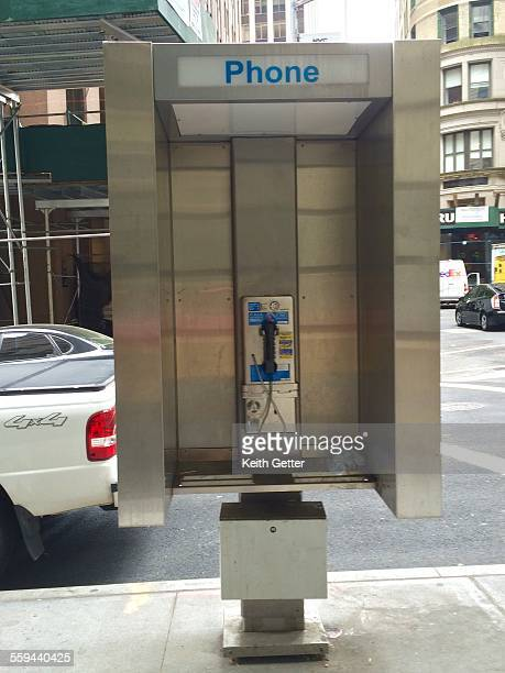 An open public phone booth on Wall Street in the financial district of Manhattan NYC May 28 2015