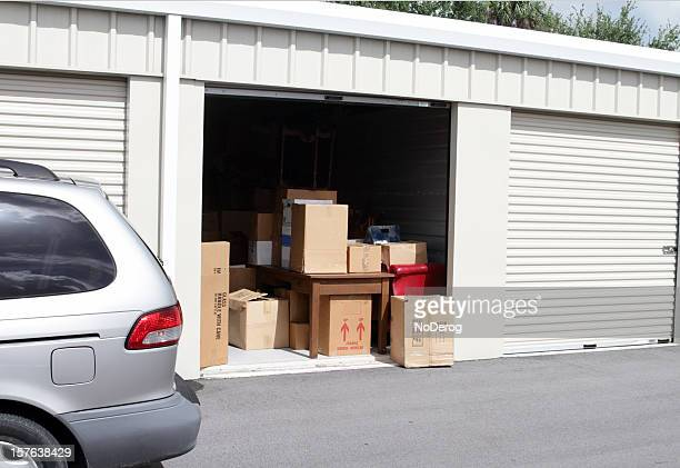 an open self storage unit with a van parked next to it - storage compartment stock pictures, royalty-free photos & images