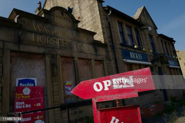 An Open sign is pictured outside a boardedup public house close to the John Smith's Stadium ahead of the Brexit Party rally on May 13 2019 in...