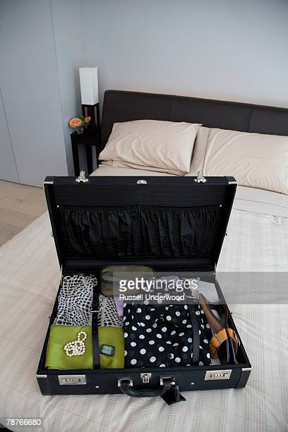 An open suitcase on a bed