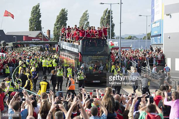 An open top bus carrying the Wales team arrives at the Cardiff City Stadium on July 8 2016 in Cardiff Wales The players toured the streets of Cardiff...