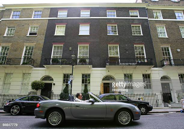 An open top car drives past UK Prime Minister Tony Blair's new house in London UK Thursday May 31 2007