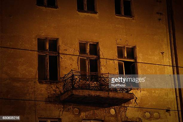 An open window is seen in an abandoned building in the citys main street Bydgoszcz Poland on December 27 2016
