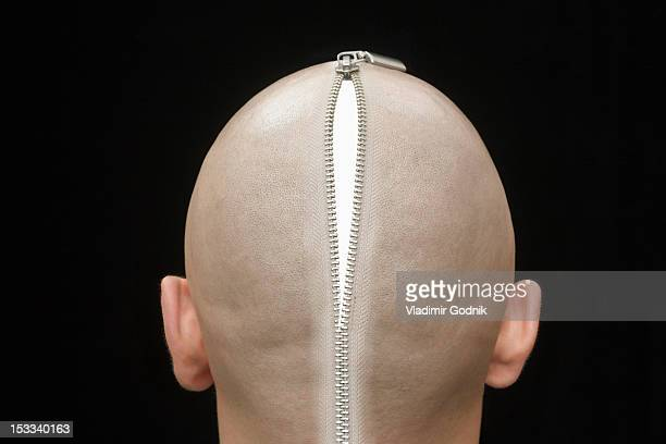 An open zip on the head of a man, rear view