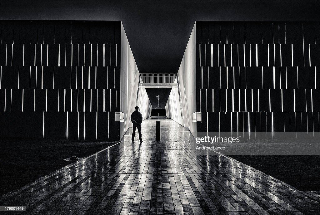 Silhouette of man and architecture at night : News Photo