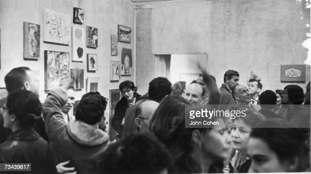 An opening around Christmastime for a group show at the Tanager Gallery 90 East 10th Street New York late 1950s or early 1960s