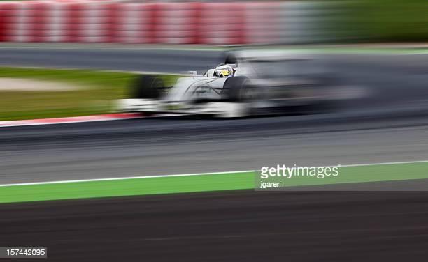 An open-wheel race car in motion
