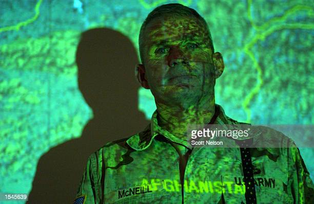 An operational map of an area in Afghanistan is projected against US Army General Dan McNeill Coalition Joint Task Force 180 commander inside the...