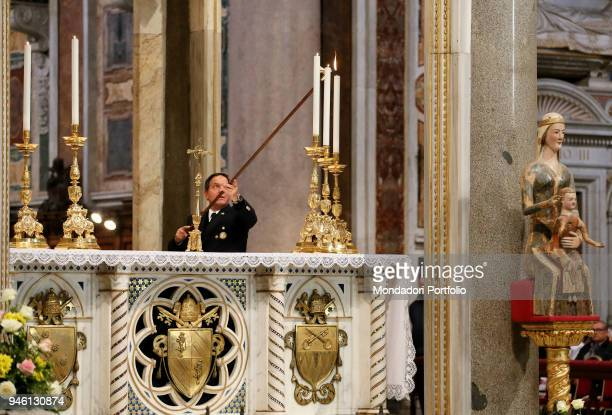 An operator lighting the candles while Pope Francis celebrates the Holy Mass for the Jubilee of the 800 years of the foundation of the Order of...
