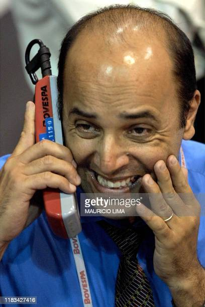 An operator of the Brazilian stock market Bovespa reacts during trading 04 July 2001 in Sao Paulo. Due to the rumors of the possible resignation of...