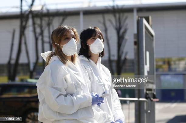 An operator performs antiCoronavirus checks during the Serie A match between Parma Calcio and SPAL at Stadio Ennio Tardini on March 8 2020 in Parma...