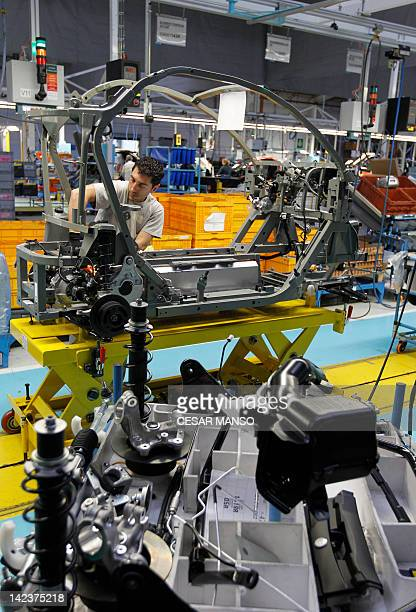 An operator works at the assembly line of a Renault Twizy electric car on April 03, 2012 in Valladolid. The Renault Twizy electric car, manufactured...