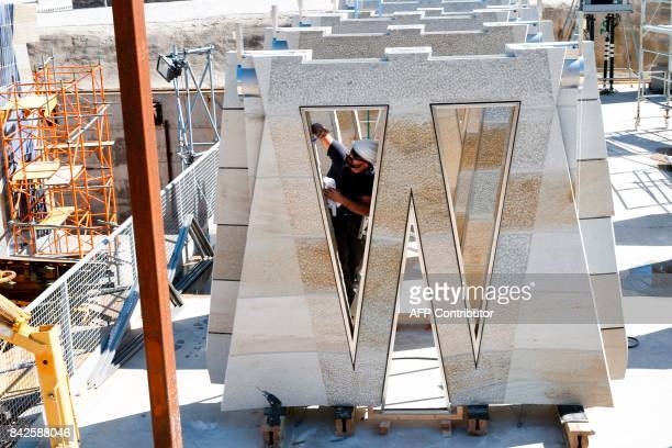 """An operator works on prefabricated structures for the Expiatory Church of the """"Sagrada Familia"""" basilica, designed by Spanish architect Antoni Gaudi,..."""