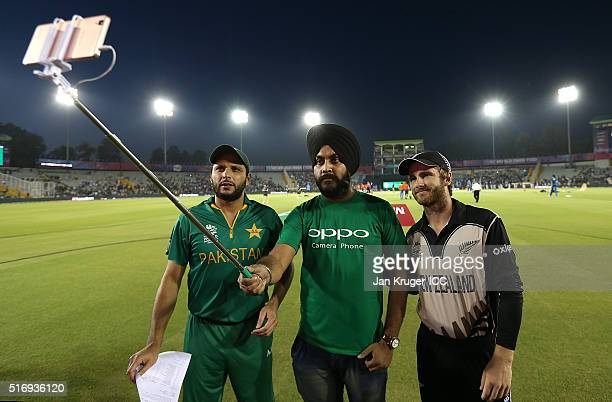 An Oppo competition winner takes a selfie with Kane Williamson Captain of New Zealand and Shahid Afridi Captain of Pakistan during the ICC World...