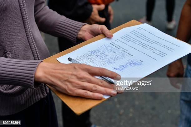An opposition activiss signs a petition against the National Constituent Assembly that promotes of the government of Venezuela's President Nicolas...