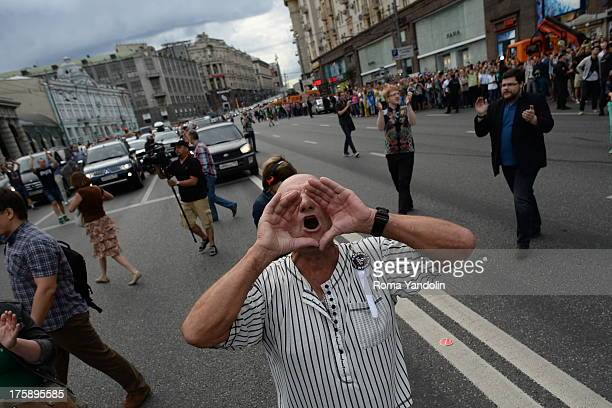 An opposition activist shouts slogans during a rally against the verdict of a court in Kirov, which sentenced Russian opposition leader Alexei...