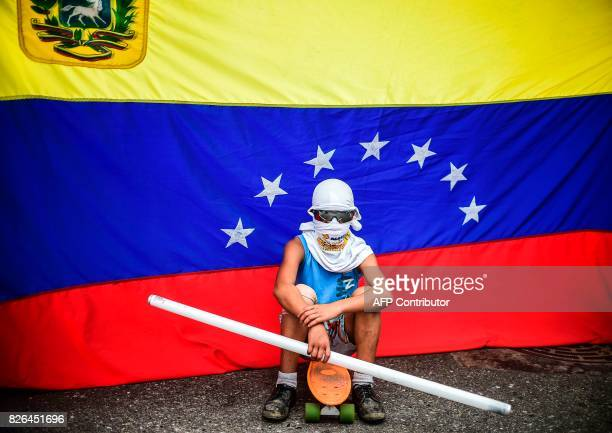 TOPSHOT An opposition activist stands by during a protest against the newly inaugurated Constituent Assembly in Caracas on August 4 2017 Venezuelan...
