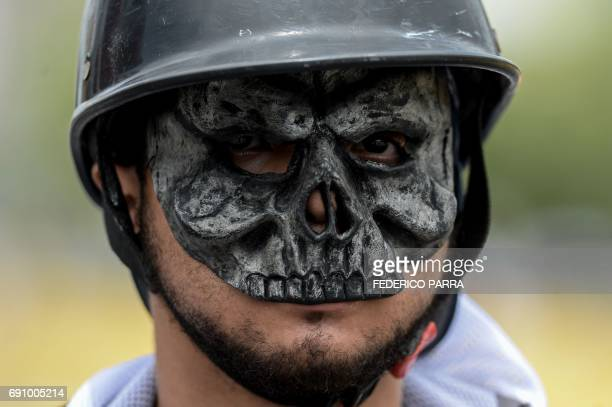 An opposition demonstrator during clashes with riot police on May 31 2017 in Caracas Venezuelan authorities on Wednesday began signing up candidates...