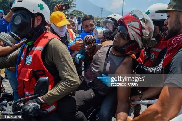An opposition demonstrator injured when Venezuelan security forces used an armored vehicle to ram demonstrators during clashes in the surroundings of...