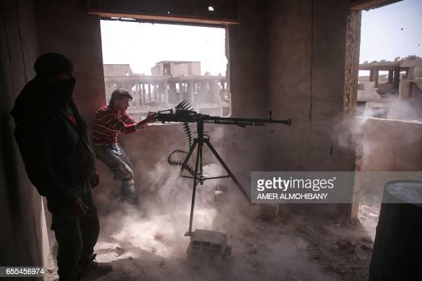 TOPSHOT An opposition fighter from the Failaq alRahman brigade fires a heavy machine gun in Jobar a rebelheld district on the eastern outskirts of...