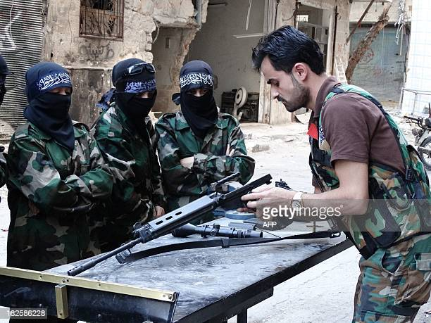An opposition fighter trains young women in the Salah alDin neighbourhood of the northern Syrian city of Aleppo on September 30 2013 Aleppo Syria's...