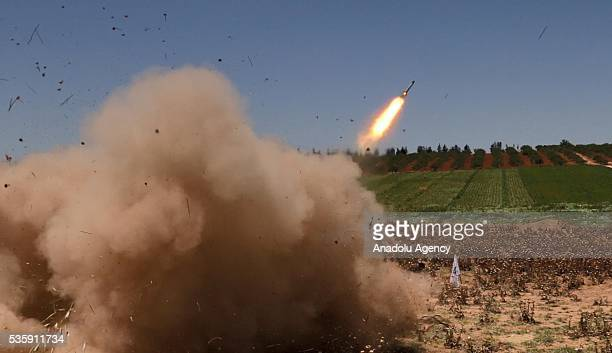 An opposition group's members stage a missile attack in Hama Syira on May 30 2016 against Assad Regime forces' Nahl checkpoint located at the...