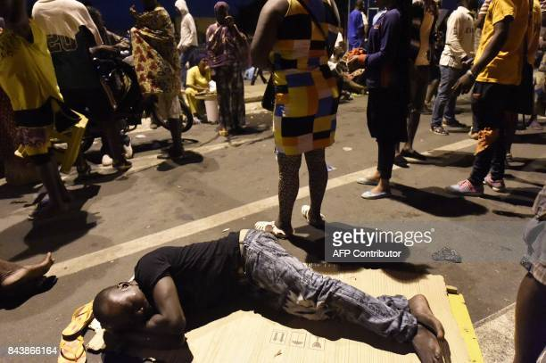 An opposition protester sleeps on the road as protesters keep an allnight vigil to press for constitutional reform during antigovernment protests led...