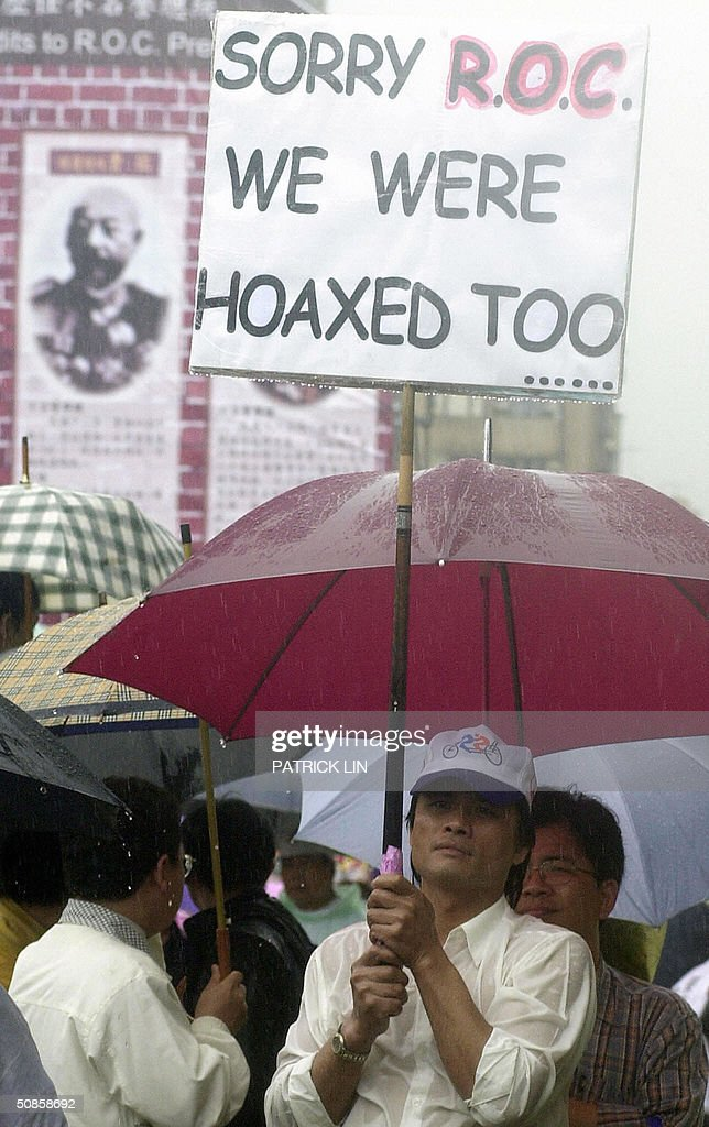An opposition supporter holds a placard during a protest rally in Taipei 20 May, 2004 as Chen was sworn in as the president for the second four-year term. The opposition is disputing Chen's re-election claiming it was the result of unfair election. Chen won the 20 March presidential polls by a razor-thin margin of 0.22 percent, or 30,000 votes.