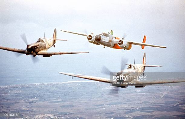 An optical merged image of the camera plane a North American B25 Mitchell and two Spitfires during the filming of 'Battle Of Britain' which recreated...