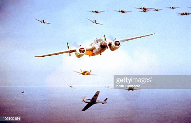 An optical merged image of the camera plane a North American B25 Mitchell and a dogfight over the UK during the filming of 'Battle Of Britain' which...