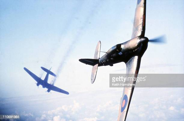An optically merged image of a Heinkel bomber under attack from a Hawker Hurricane fighter over England made after aerial shots were filmed for...